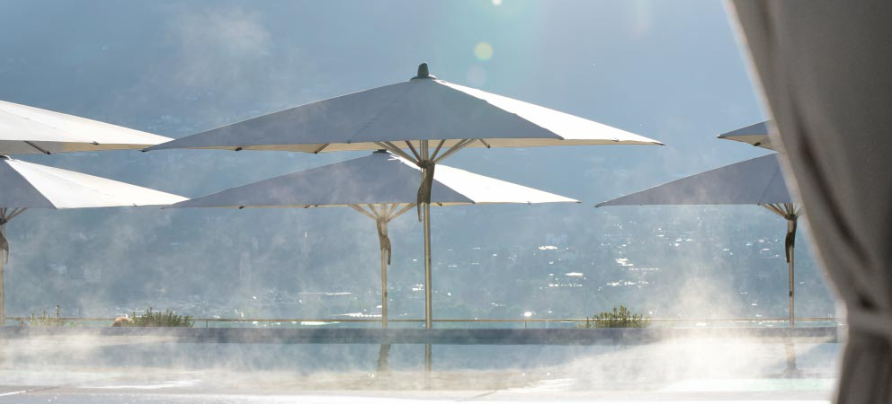 View of beach umbrellas of the swimming pool of the 5-star hotel in Merano
