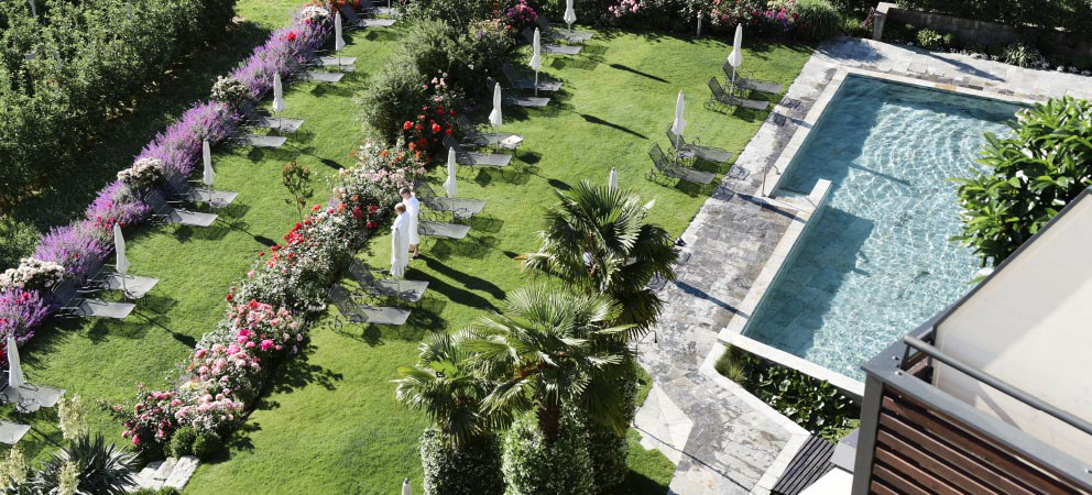 Top view of the swimming pool of Hotel Giardino Marling in Merano