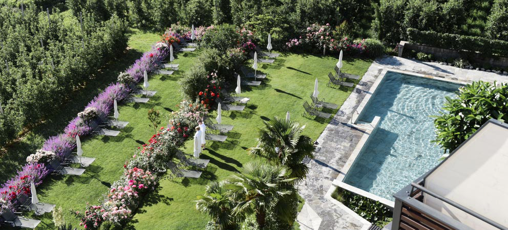 Top view of the garden and the swimming pool of the Hotel in Merano